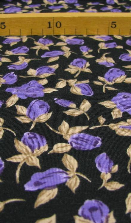 Tricot zwart met bloemen Gossypium