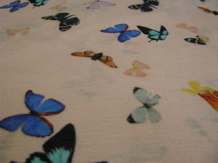 Fijn gebreide stof met vlinders Gossypium