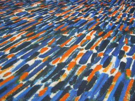 Tricot met streepjes blauw en oranje Gossypium